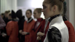 Backstage fashion show. Girl model is waiting for the start of the show Footage