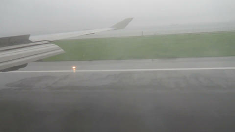 Aircraft landing in rain Aircraft landing in rain Footage