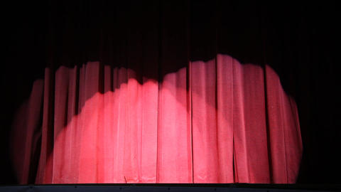 Red stage curtain illuminated by several lights, turn off and back on Footage