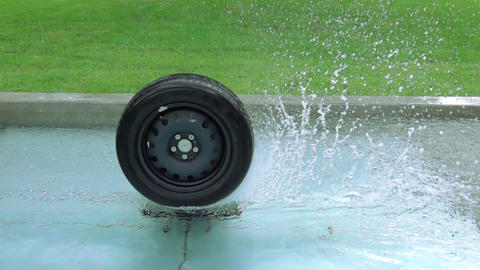 Fountain with the Car Wheel and Water Splashes. Slow Motion Footage