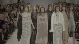 A lot of girls models the final show of the fashion show Footage
