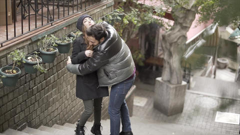 Young couple hug on street - Slow Motion Footage
