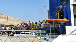 Tourists arriving to Santorini's port on board Seats catamaran super ferry from Footage