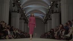 The wide runway where there is a female model during a fashion show Footage