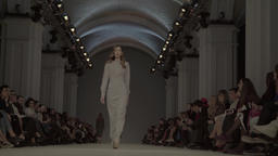 The girl model is on the catwalk in fashion show Footage