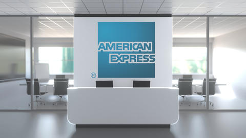 Logo of AMERICAN EXPRESS on a wall in the modern office, editorial conceptual 3D Footage