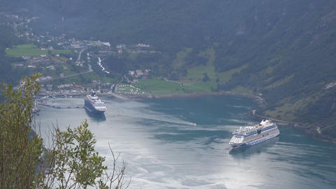 two large cruise liners are moored in Geiranger in Norway Footage