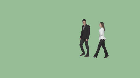Young man and girl in smart casual are strolling, smiling, laughing.Green screen Footage