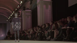 A girl walks down the runway during a fashion show Footage