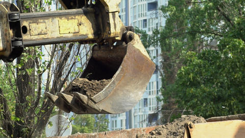 Excavator Bucket land transfers in the body of the truck Footage