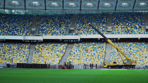 Construction work on the big stadium with the projector and the screen Footage