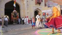 Decorated elephant walks in procession through gate,Jaipur,Gangaur,India Footage