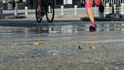 female runners ran through puddles of water splashing under running shoes Footage