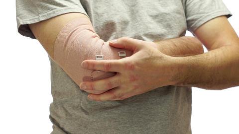 Man Medical Tension Bandage Elbow Live Action