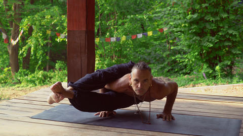 Yogi quickly takes exercise, body lifting arms Footage