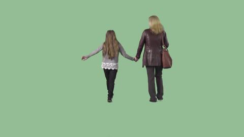 Mother and daughter are going from the camera. Footage with alpha channel Footage