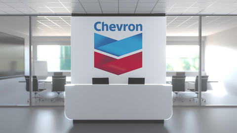 Logo of CHEVRON CORPORATION on a wall in the modern office, editorial conceptual Live Action