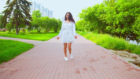 front view young woman walking to the camera have fun Footage