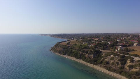 Aerial view of coast with beautiful nature by the turquoise and blue sea Live Action