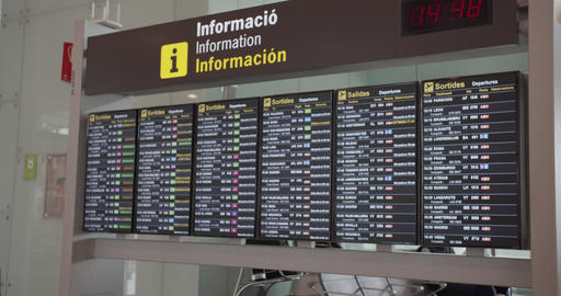 Barcelona, Spain - October 20, 2019: Woman passenger looking at timetable board Archivo