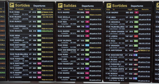 Flight information displayed on airport departure board. Airport timetable and Archivo
