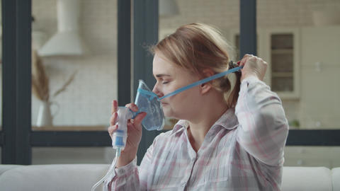 Female doing inhalation treatment with nebulizer Footage
