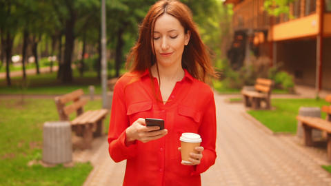 caucasian female typing message use smartphone outdoors Footage