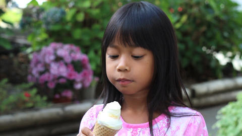 Little Asian Girl Eating Ice Cream Cone Stock Video Footage