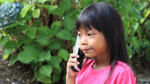Little Asian Girl Talking On Phone Stock Video Footage