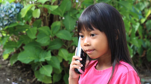 Little Asian Girl Talking On Phone Stock Video Footage