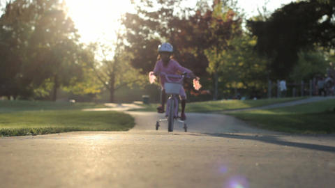 Little Girl Rides Her Bike Down The Hill Stock Video Footage