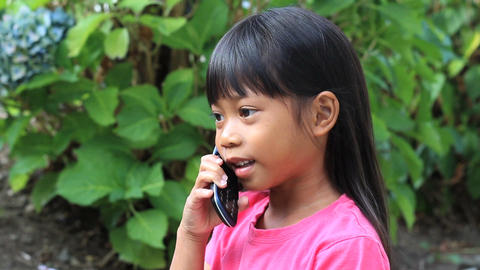 Little Girl Talking On Cell Phone Stock Video Footage
