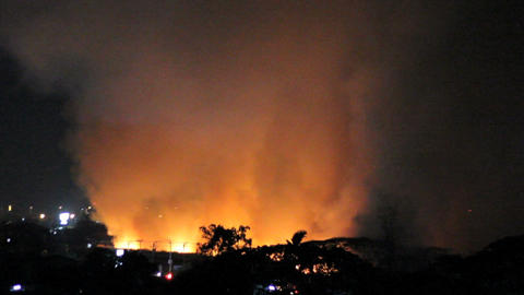 Night Fire Burns Out Of Control In Field Stock Video Footage