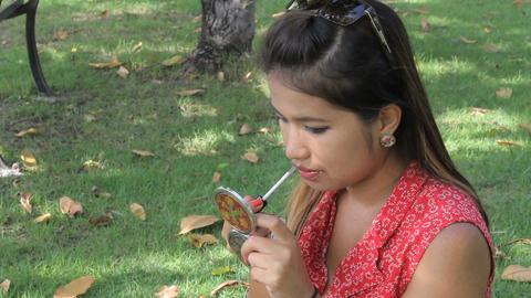 Pretty Asian Girl Applies Lip Gloss Stock Video Footage