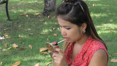 Pretty Asian Girl Applies Lip Gloss Footage