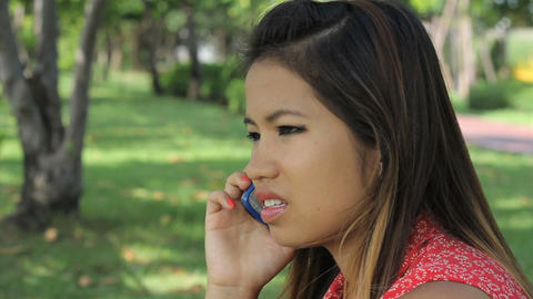 Pretty Asian Girl Having A Serious Cell Phone Call Stock Video Footage