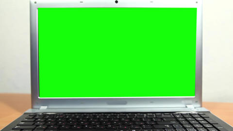 Notebook with a green screen Footage