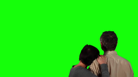 Happy couple over green screen 2 Stock Video Footage