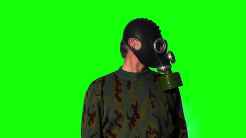 Man in gas mask on a green screen Footage