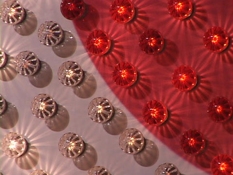 Red and white lights flash rhythmically on a sign Stock Video Footage