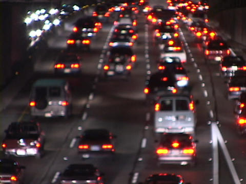 Freeway traffic creates a blur of red and yellow lights Stock Video Footage