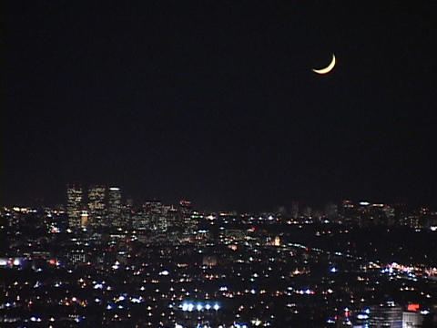 A new moon dominates the night sky over the city of Los Angeles Footage