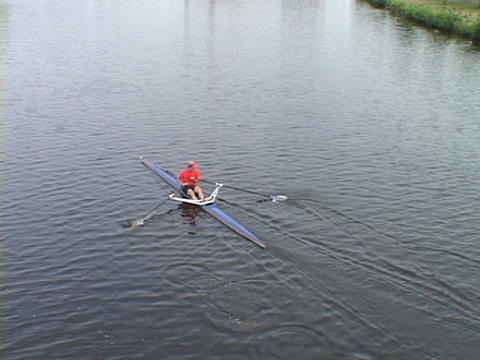 A sculler rows a skiff on the Charles River in Boston, Massachusetts Footage