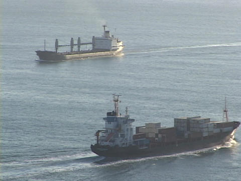 cargo ships pass on the ocean Footage
