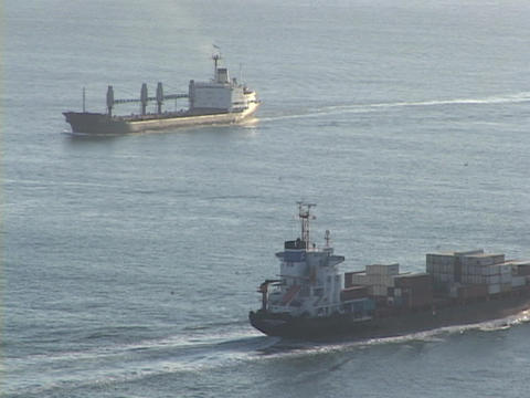 cargo ships pass on the ocean Stock Video Footage