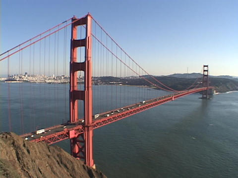 Traffic drives on the Golden Gate Bridge in San Francisco, California Footage