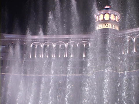 Fountains spray in front of the Bellagio-Hotel and Casino in Las Vegas at night Footage