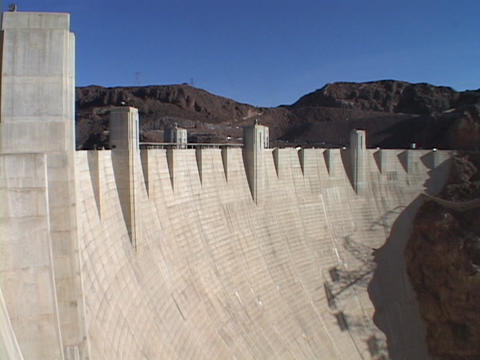 Mountains peak over the majestic Hoover Dam Footage