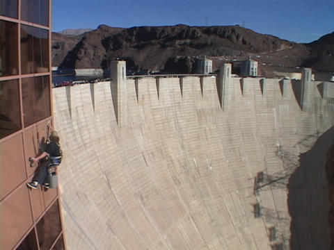 A window washer works at the Hoover Dam Footage