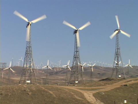 Large windmills spin at a wind-farm Footage